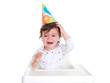Baby crying - wearing party hat