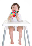 Baby laughing holding lollypop
