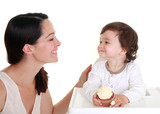 Mother and baby with cupcake