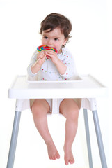 Baby biting lollypop