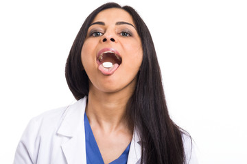 Doctor showing a medicine on the tongue