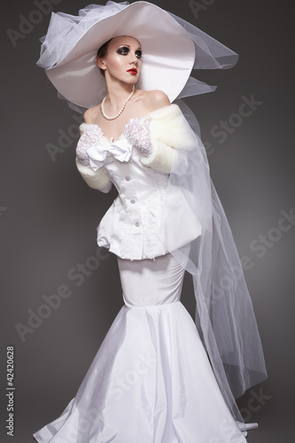 Chic aristocratic woman in retro style dress and hat