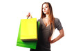 Attractive blonde girl with shopping bags isolated