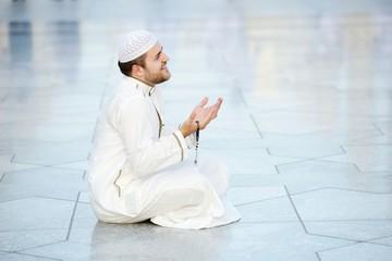 Muslim prayer at holy mosque