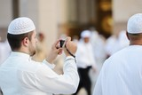Muslim taking photo at Madina haram