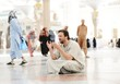 Muslim praying at Medina mosque