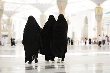 Three Moslim women walking outdoors
