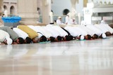 Muslims praying together at Holy mosque