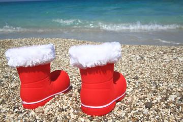 Santa Claus boots on the beach