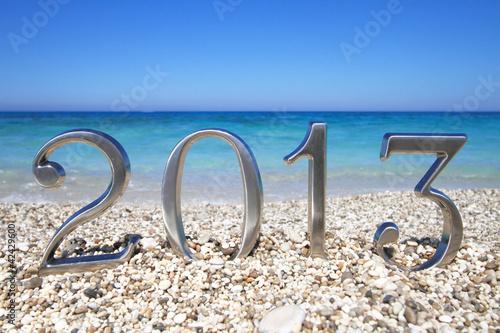 Leinwandbild Motiv New year 2013 on the beach