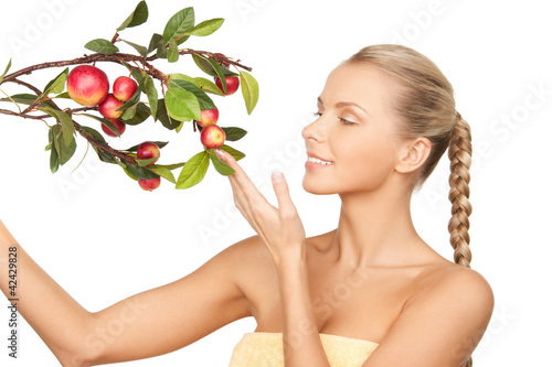 lovely woman with apple twig