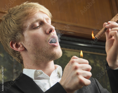 Business man smoking a cigar