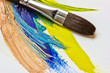 colored paints and brushes for painting
