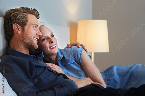 relaxing couple in a hotel room