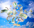 American dollars banknotes and coins falling from blue sky