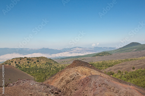 The volcano Etna landscape in a blue sky