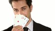 businessman holding aces poker cards