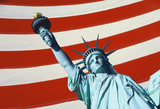 This is a digitally created image of the Statue of Liberty. The statue is the top part of her body with arm and torch coming form the right hand corner of the image. The background has the red and white stripes of the American flag.