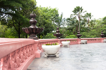 A view of an elegant, curving in pink terrace