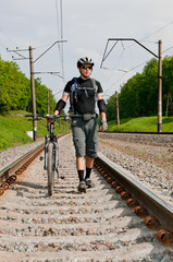 Сyclist goes by rail