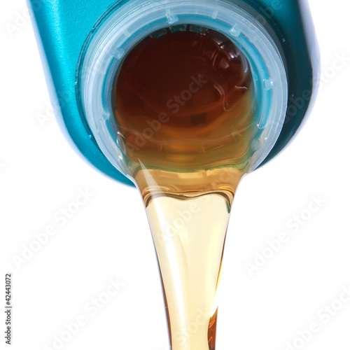 Flowing lubricating oil. Closeup.