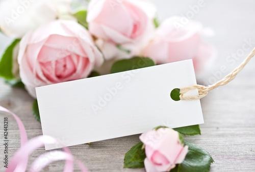 Label with roses on background