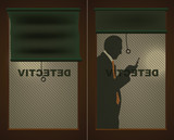 Detectives door and a silhouette of a man with a cell phone
