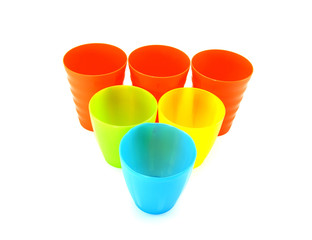 Colorful plastic cups over white background