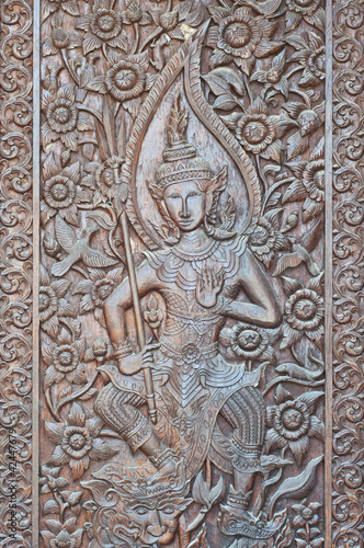 Angel woodcraft on temple door.