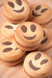 Close-up of smiley biscuits on a wooden board