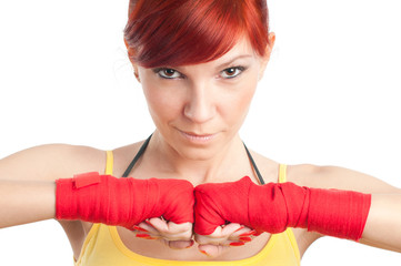Caucasian female boxer posing on white background