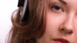 Beautiful girl listening to romanting music.