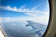 Looking over aircraft wing in flight - 42450274
