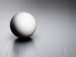 Metal ball on brushed steel plate