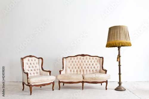 vintage luxury armchair in white room