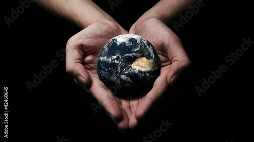 The world is yours ( hands holding a rotating earth ) repeatable