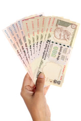 Hand holding Indian rupee notes on white background