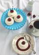 Meringue nests with cream and fresh sweet cherry