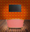 television and sofa in orange wallpaper room