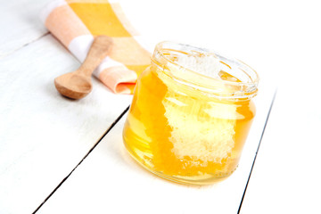 honey with a wooden spoon