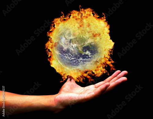 Hand holding burning earth(Earth view image from http://visiblee