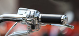 Steering wheel motorcycle throttle control lever close up