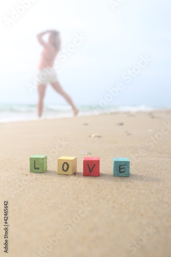 LOVE - written on wood cubes at the beach
