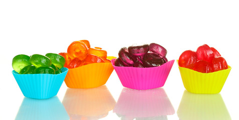 Tasty colorful candies isolated on white background