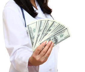 Dollars in the hands of a female doctor