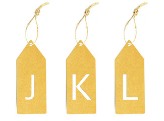 Brown paper tag with letter J K L cut