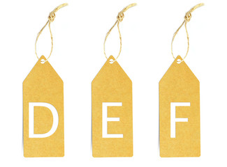 Brown paper tag with letter D E F cut