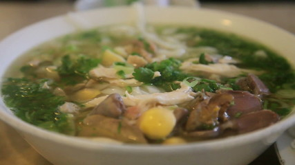 Vietnamese Pho, with someone eating it