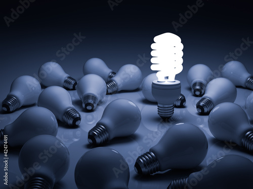 Lit energy saving lightbulb amongst unlit incandescent bulbs