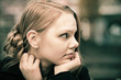 Pensive young blond woman